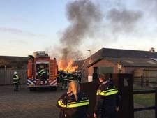 Tuinhuisje vliegt in brand in Mill