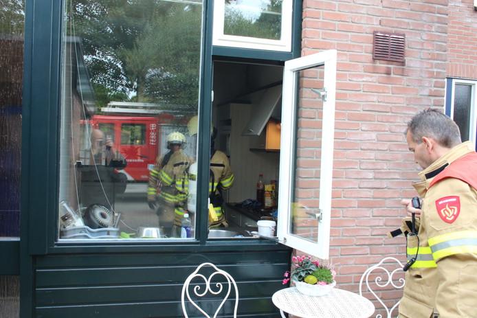 Alleen de afzuigkap liep lichte schade op bij de brand.