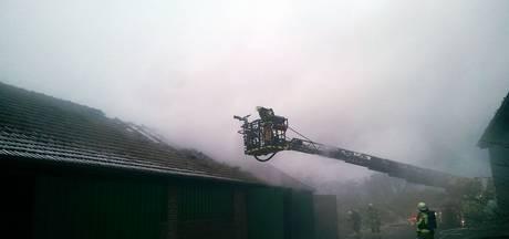 Forse schade bij brand in schuur, woning gered