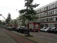 Grote brand in woning in Rotterdam-Delfshaven