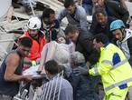Foto's aardbeving Italië: gebied in puin, eerste reddingsacties