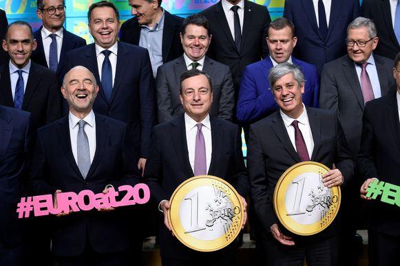 Pierre Moscovici (L) Mario Draghi en Mario Centeno .