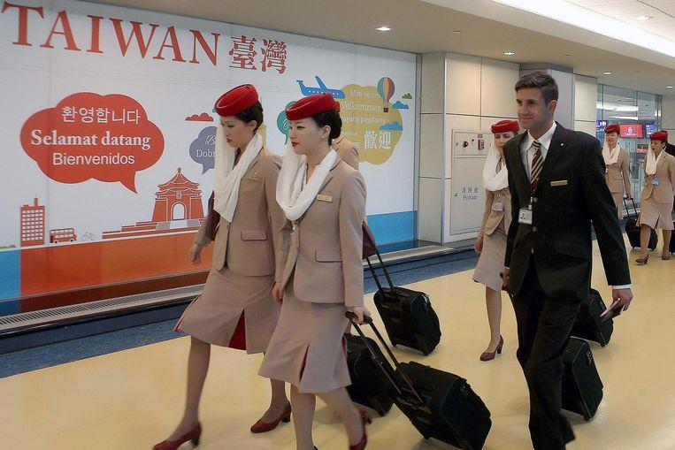 Personeel van Emirates, zónder speldje. Beeld afp