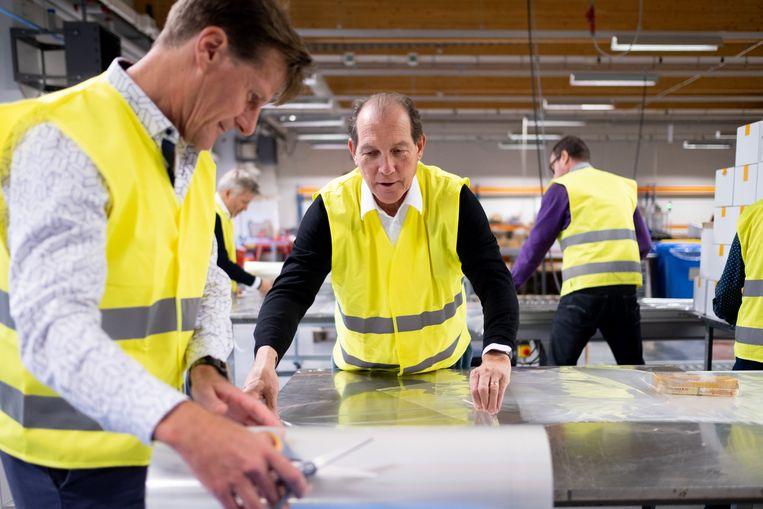 Rotary Club Willebroek/Klein-Brabant gaat zelf pakketten inpakken aan de lopende band bij Flexpack