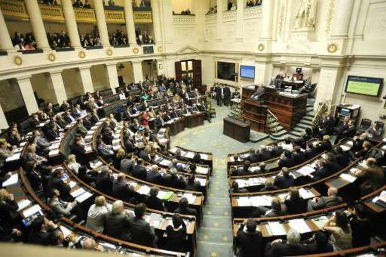 Premier Leterme legt zijn regeerverklaring af in een nokvolle Kamer