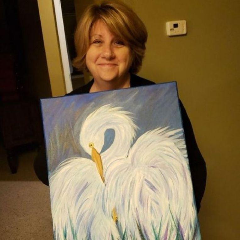 Cindi Decker met haar originele schilderij.