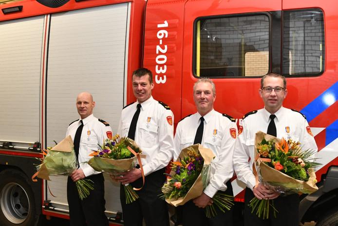 De geridderde brandweermannen in Woubrugge v.l.n.r. Pieter van der Laan,  Marcel Zwetsloot, John van der Salm en Hans van Wouwe.