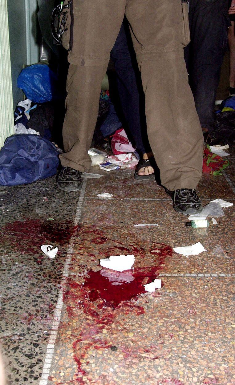 Een plas bloed in de school waar demonstranten bivakkeerden toen de politie daar binnenviel. Beeld ap