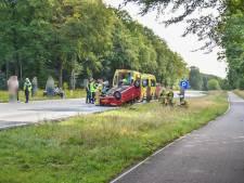 Auto slaat over de kop na botsing met trike op Amsterdamseweg
