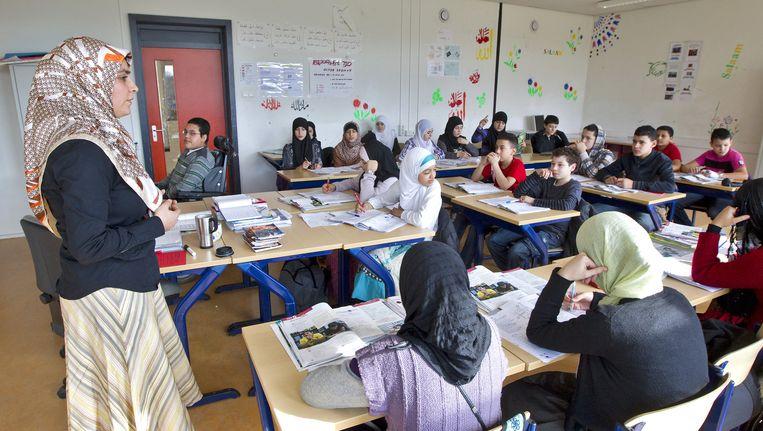 Les in een klaslokaal van het Islamitisch College aan de Jacob Geelstraat, dat in 2010 werd gesloten Beeld anp