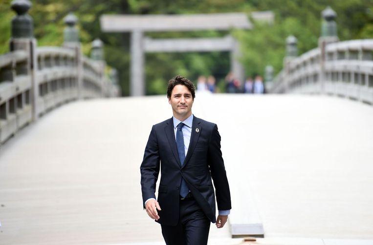 De Canadese premier Justin Trudeau arriveert op de vergaderlocatie tijdens de eerste dag van de G7. Beeld afp