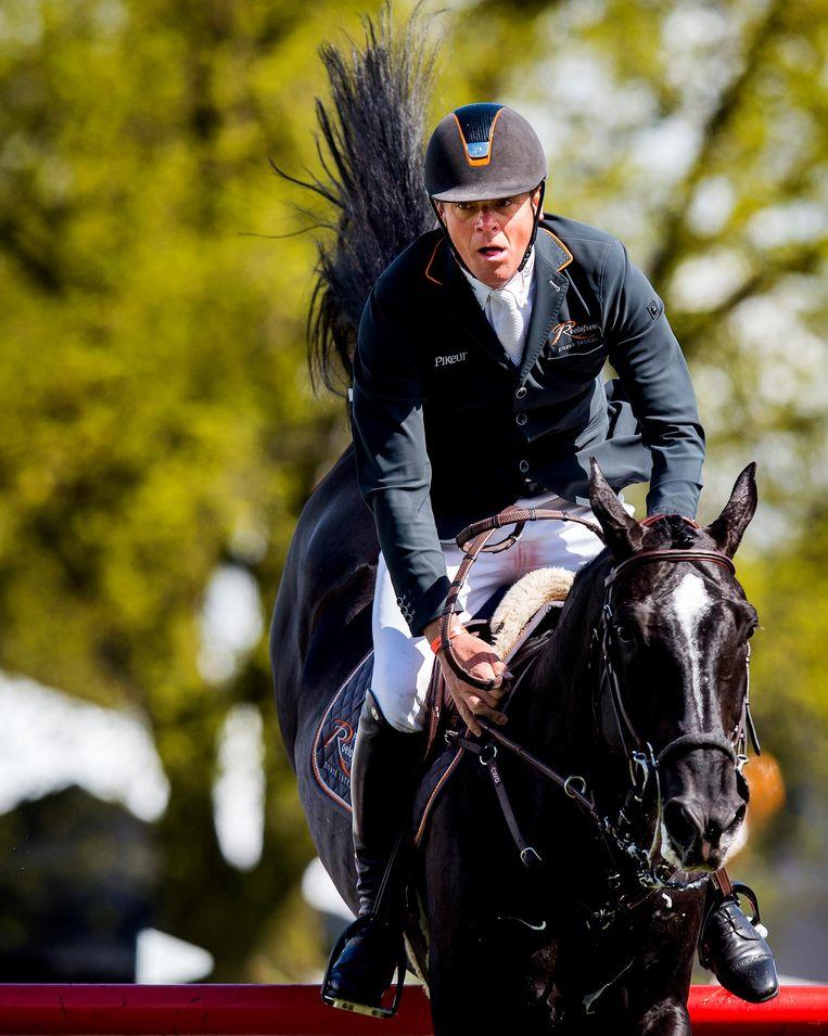 Jeroen Dubbeldam op zijn paard Zenith. Beeld anp