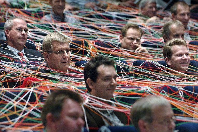 4 tot 6 ton is het optimale salaris voor managers, schrijven onderzoekers.   Beeld Marcel van den Bergh / de Volkskrant
