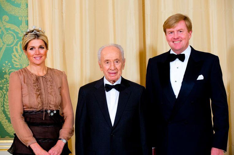 In 2013 kwam Shimon Peres op uitnodiging van koning Willem Alexander naar Nederland. Beeld Robin Utrecht