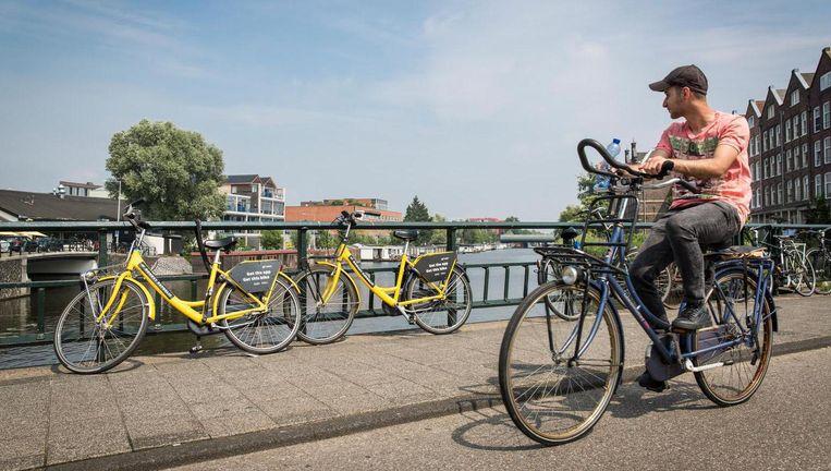 Deelfietsen in Amsterdam Beeld Dingena Mol