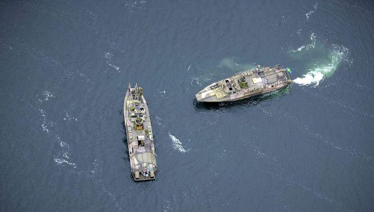 Schepen van de Zweedse marine zoeken sinds vrijdag in de Oostzee naar een mogelijk Russische onderzeeboot die in problemen zou zijn. Beeld epa