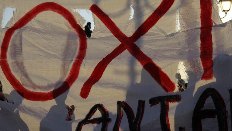 Demonstranten in Athene protesteren tegen de bezuinigingen. Beeld anp