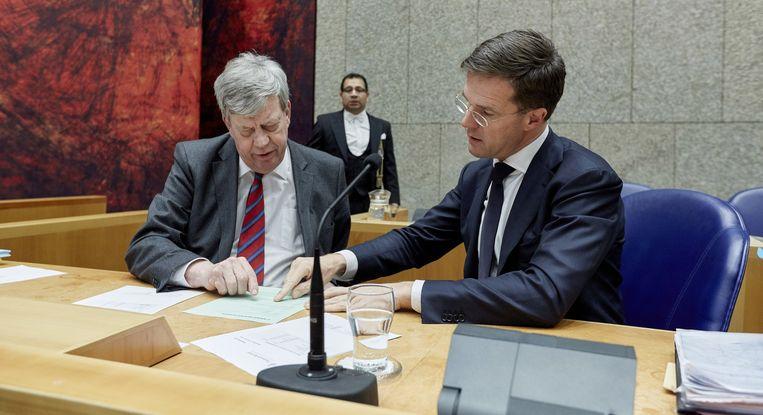 Ivo Opstelten en Mark Rutte tijdens een debat in de Tweede Kamer Beeld anp