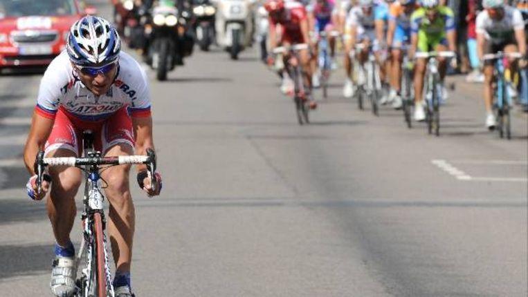 De Russische wielrenner Serguei Ivanov tijdens zijn ontsnapping in de 14e etappe (AFP) Beeld