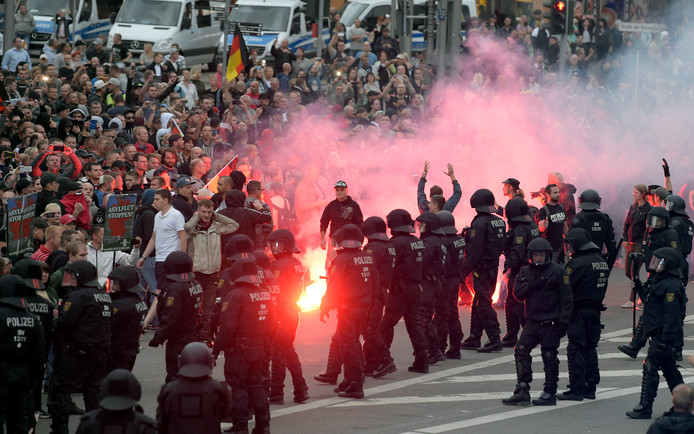 "FILE - In this Aug 27, 2018 file photo protesters light fireworks during a far-right demonstration in Chemnitz, Germany, after a man has died and two others were injured in an altercation between several people of ""various nationalities"" in the eastern German city of Chemnitz on Sunday. (AP Photo/Jens Meyer, file)"