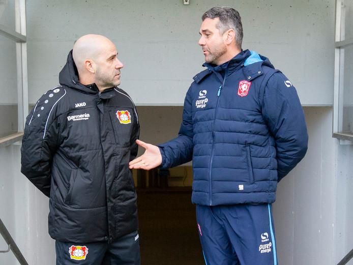 Peter Bosz met Marino Pusic, de trainer van FC Twente.