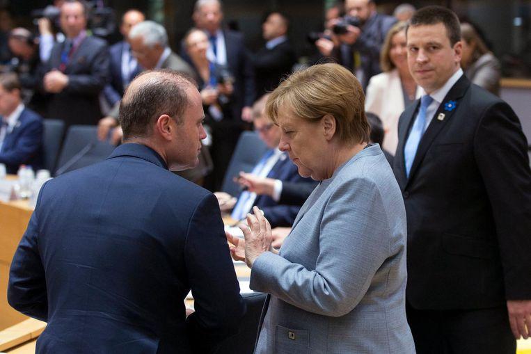 Muscat en Merkel. Beeld afp