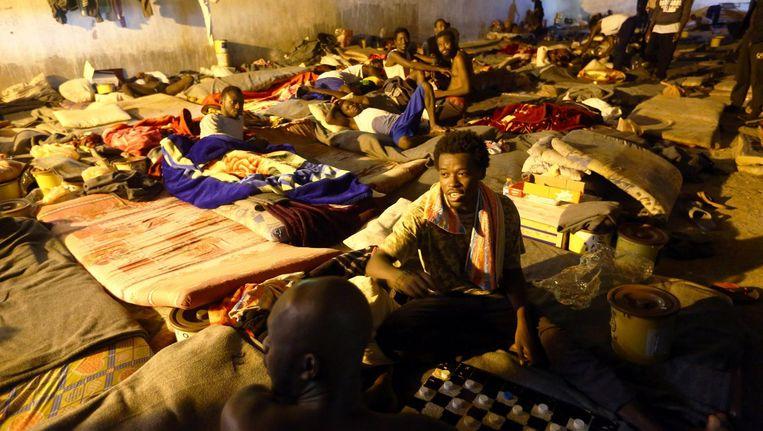 Een detentiecentrum voor migranten in Libië. Beeld afp