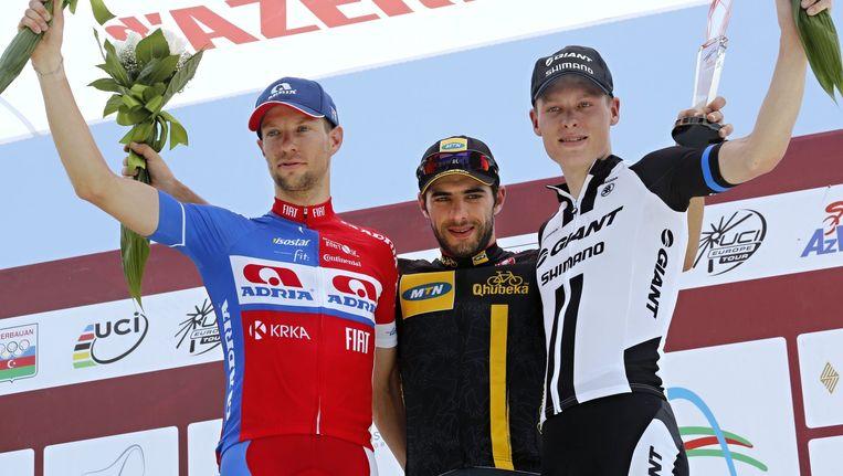Winnaar Reguigui wordt op het podium geflankeerd door Mugerli (2e) en Haugaard Jensen (3e)
