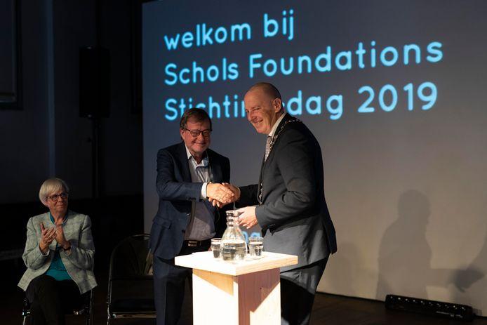 Karel Schols wordt onderscheiden.