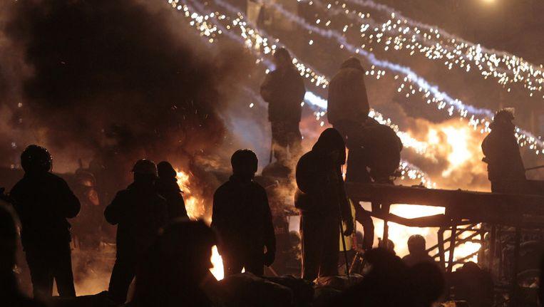 Demonstranten keren zich tegen de politie. Beeld ap