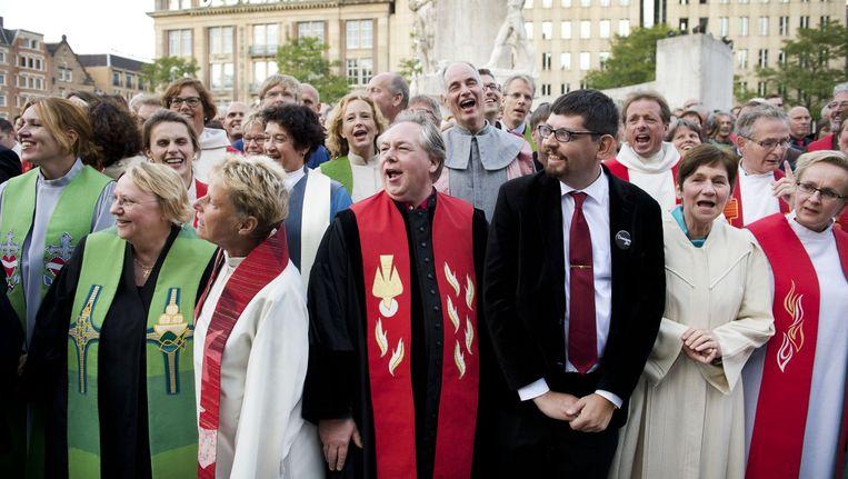 September 2014: dominees van de Protestantse Kerk in Nederland kwamen ter gelegenheid van 'predikantendag' samen op de Dam. Beeld anp