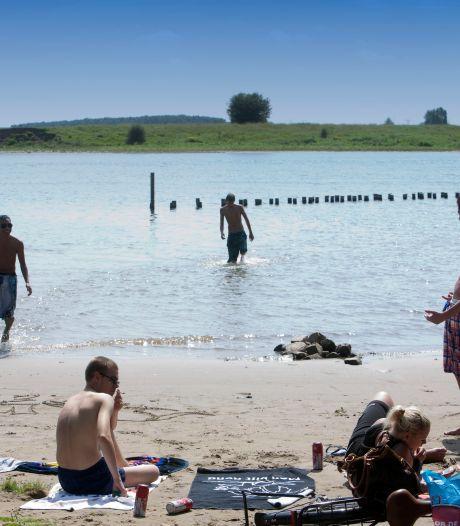 Zwemmen in een rivier of plas? Zoveel poepbacteriën zitten er in het water