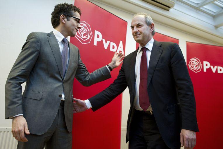 Job Cohen en vice-fractievoorzitter Jeroen Dijsselbloem op het partijbureau in Amsterdam tijdens een persconferentie over het aftreden van Cohen als politiek leider van de PvdA. Beeld null