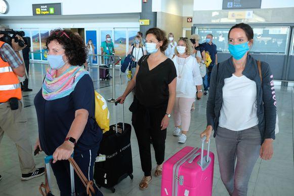 Toeristen met mondmaskers, ter illustratie.