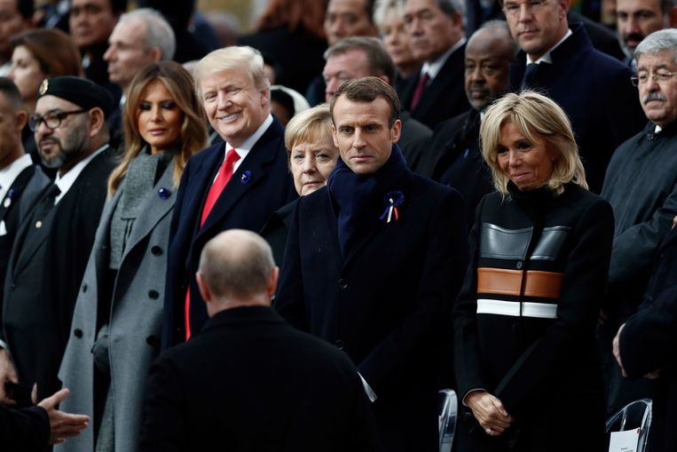 De Amerikaanse president Donald Trump, Duitse Bondskanselier Angela Merkel en Franse president Emmanuel Macron  tijdens de herdenking in Parijs. Beeld AFP