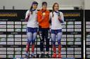 Ireen Wüst op de hoogste trede na de 1500 meter met naast zich de Russinnen Evgeniia Lalenkova en Elizaveta Kazelina.