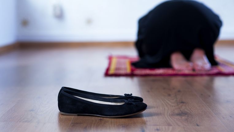 Een biddende moslima. Beeld anp