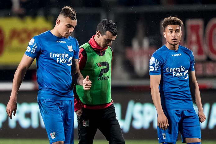 NEC'ers Jay-Roy Grot, Ali Messaoud en Arnaut Groeneveld verlaten teleurgesteld de Grolsch Veste.