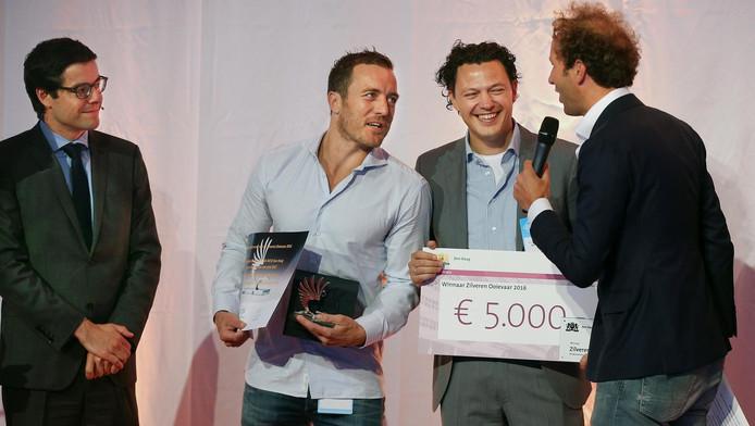 De winnaars van de Zilveren Ooievaar, softwarebedrijf eVision.