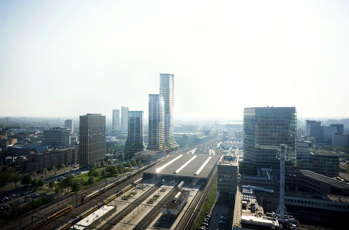 Het station van Eindhoven met daarachter de 3 torens van District E, het plan voor het Stationsplein.