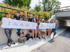 Scholieren ontwerpen wandtekening om graffiti in fietstunnel te voorkomen