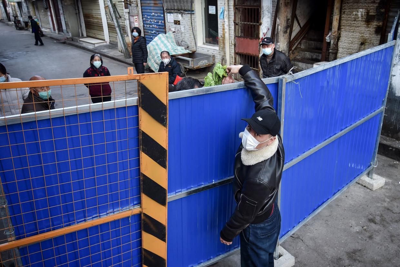 In westerse media werd veel geschreven over de lockdown in Wuhan als typisch product van een totalitaire staat. Beeld AFP