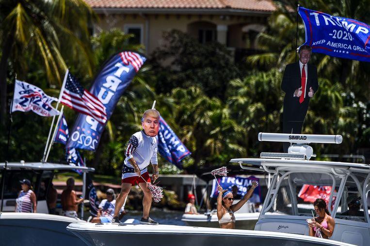 Groene cijfers kan Trump gebruiken om zichzelf te verkopen als handig zakenman die het land rap weer op de been krijgt. Beeld AFP