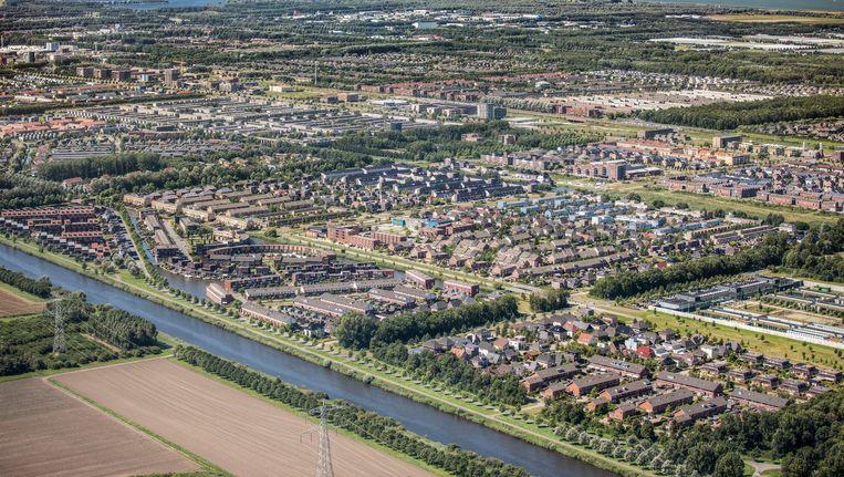 De Almeerse Stripheldenbuurt gezien in westelijke richting met op de achtergrond Amsterdam Beeld Peter Elenbaas