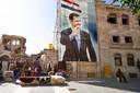 De beeltenis van Basher al-Assad is terug in het straatbeeld van Aleppo. AP Photo/Alexander Zemlianichenko