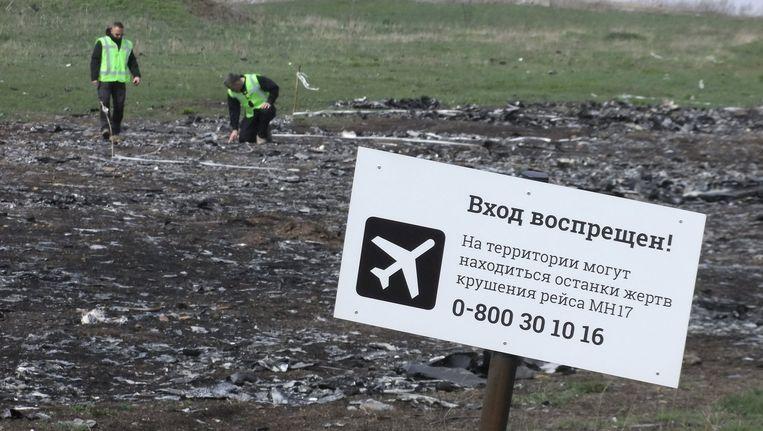 Een bord met de tekst 'Geen toegang' op de rampplek van MH17. Beeld reuters