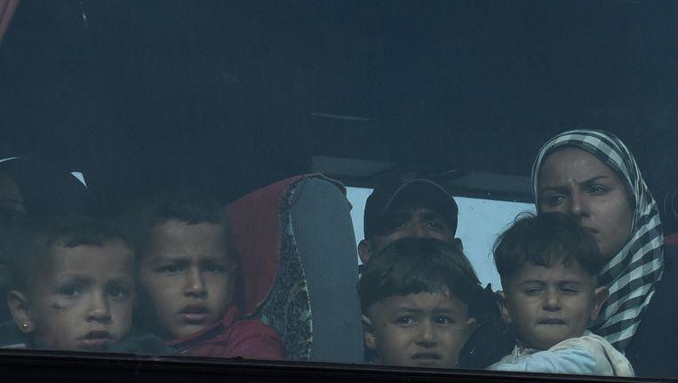 Kinderen tijdens de evacuatie van Idomeni. Beeld null