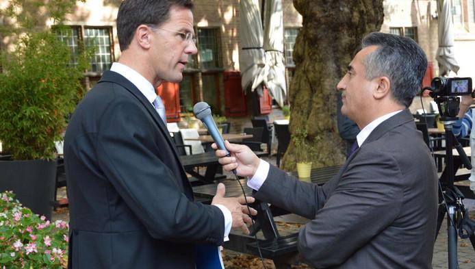 Basri Dogan interviewt Rutte.