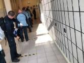 Alphense gevangenismedewerkers en Woerdense scholier besmet met corona