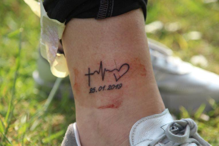 De tatoeage van Alicia.